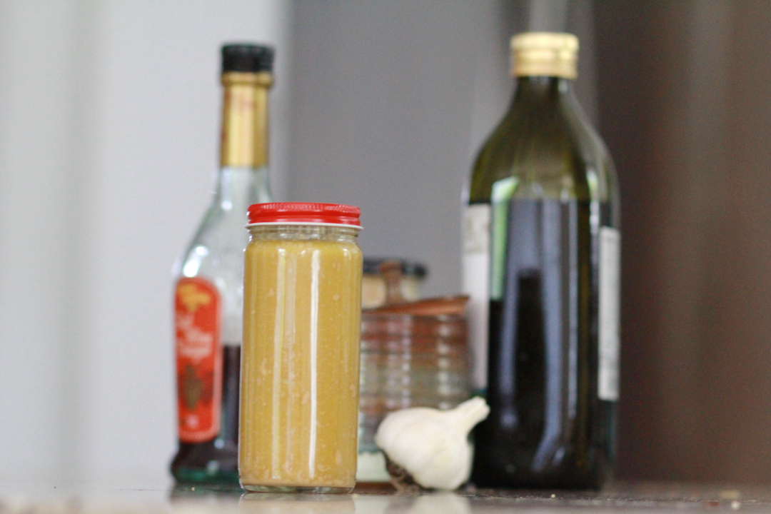 classic French dressing, bottles with oil, vinegar, dressing, and a garlic bulb