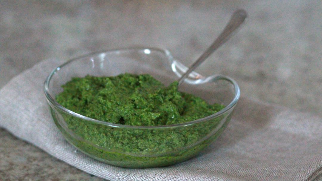 green pesto on grey background