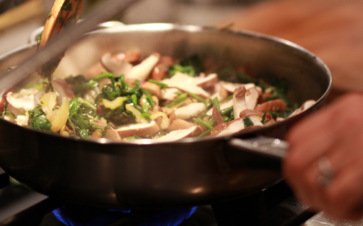 quinoa shiitake and chard saute in a pan